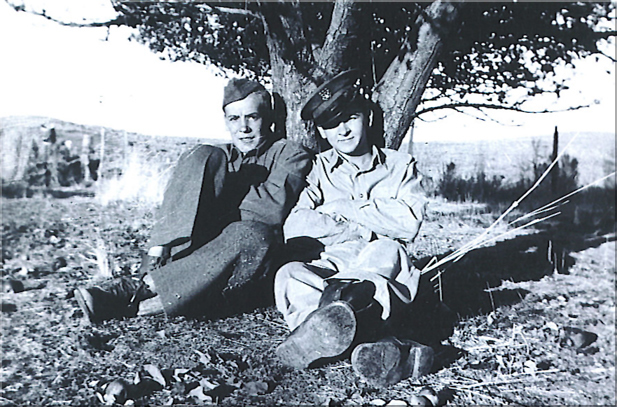Stanley S. Jamraz with a friend sitting at a tree